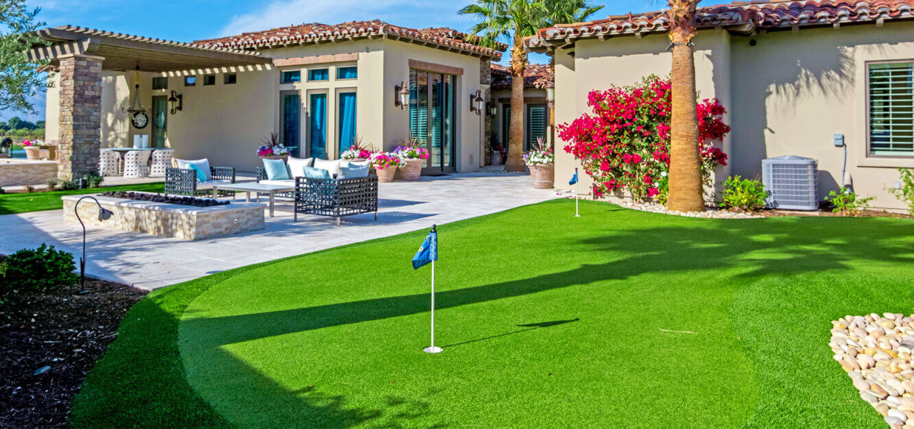 Outdoor living space with putting green.